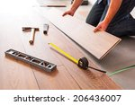 man installing new laminated... | Shutterstock . vector #206436007