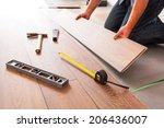 man installing new laminated... | Shutterstock . vector #206436007