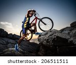 bicycle rider crossing rocky... | Shutterstock . vector #206511511