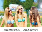 happy friends talking on summer ... | Shutterstock . vector #206552404