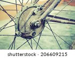 Small photo of Close up shot of bicycle crank, chain, derailleur and rear wheel.