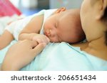 baby sleeping on the mother's... | Shutterstock . vector #206651434
