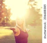 woman doing yoga warrior pose...   Shutterstock . vector #206688385