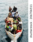 Small photo of CHILUMBA, MALAWI - AUG 17, 2009: Passengers approach in a boat to embark the ferry MV Ilala on August 17, 2009 in Chilumba, Malawi. MV Ilala is a motor ship that has plied lake Malawi since 1951.
