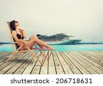 Girl relaxing on holiday with cruise ship - stock photo