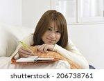 woman writing in a notebook | Shutterstock . vector #206738761