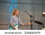 Small photo of LINCOLN, CA - July 19: Charlotte Caffey of The Go Go's perform in support of the Replay America Tour at Thunder Valley Casino Resort in Lincoln, California on July 19, 2014