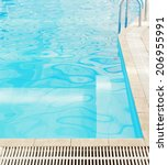 a step in the blue pool water  | Shutterstock . vector #206955991