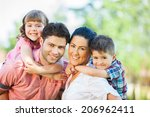 cute family portrait of 4 people | Shutterstock . vector #206962411