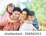 cute family portrait of 4 people | Shutterstock . vector #206962411