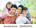 cute family portrait of 4 people | Shutterstock . vector #206962441