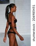 miami   july 17  model walks...   Shutterstock . vector #206985451