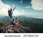 hikers standing on top of the... | Shutterstock . vector #207002725