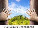 2 hands opening a wooden wall... | Shutterstock . vector #207010831