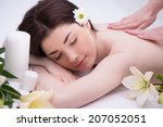 relaxed woman with flowers in... | Shutterstock . vector #207052051