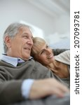 senior couple relaxing in sofa... | Shutterstock . vector #207093781