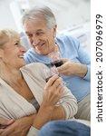 senior couple at home drinking... | Shutterstock . vector #207096979