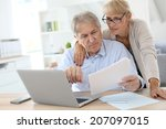 senior couple doing the income... | Shutterstock . vector #207097015