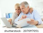 senior couple doing the income... | Shutterstock . vector #207097051