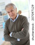 smiling senior man sitting in... | Shutterstock . vector #207097129