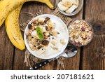 portion of banana yogurt in a... | Shutterstock . vector #207181621