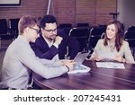 businesspeople interacting at... | Shutterstock . vector #207245431