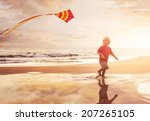 Happy Young Boy Flying Kite On...