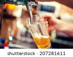 close up of barman hand at beer ... | Shutterstock . vector #207281611