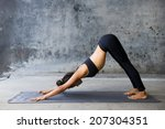young woman practicing yoga in... | Shutterstock . vector #207304351