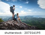 hikers standing on top of the... | Shutterstock . vector #207316195
