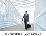 man at the airport with suitcase | Shutterstock . vector #207324529