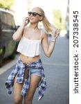 happy urban young girl talking...   Shutterstock . vector #207338545