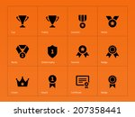medals and cup icons on orange...
