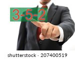 Businessman Pointing To 352...