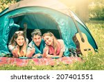 Group of best friends with thumbs up having fun camping together - Concept of carefree youth and freedom outdoors in the nature during vacations - Vintage filtered look