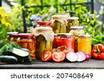 Small photo of Jars of pickled vegetables in the garden. Marinated food.