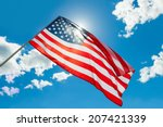 Usa Flag Waving On Blue Sky...