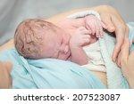 newborn baby after birth | Shutterstock . vector #207523087