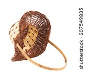 Brown wicker basket lying on its side, isolated over the white background - stock photo