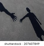 Helping Hand With A Shadow Of...