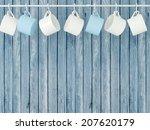 Ceramic Cups Hanging On Hooks...