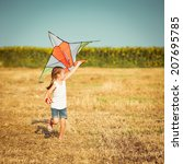 happy little girl with a kite... | Shutterstock . vector #207695785