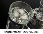 glass and bottle of water | Shutterstock . vector #207702301