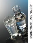 glass and bottle of water   Shutterstock . vector #207702319