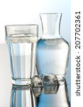 glass and bottle of water | Shutterstock . vector #207702361