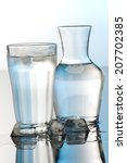 glass and bottle of water | Shutterstock . vector #207702385