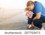 young father holding his child... | Shutterstock . vector #207703471