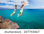 friends cliff jumping into the... | Shutterstock . vector #207743467