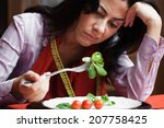 young woman bored of dieting .... | Shutterstock . vector #207758425