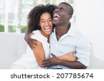 attractive couple cuddling on... | Shutterstock . vector #207785674